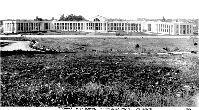 """Description: Oakland Technical High School, west side of Broadway, between 42nd and 45th streets (looking west), Temescal district, Oakland, Calif. Tower of the Matilda Brown Home for Aged Women can be seen in background on left. """"Note the absence of buildings on east side of Broadway and along the winding route of Mather Street [in foreground]"""" (Ray Raineri note).  Note: the original photo appears to have been altered: the telephone poles and connecting wires along Mather Street were partially obscured, probably by manipulating the emulsion (Jeff Norman). Date: 1919 Author: Ford E. Samuel. 470 13th St., Oakland, Calif.  Phone Oakland 3567 (from back of photo) Source: Collection of Ray Raineri. Copied: by Jeff Norman, 9/17/08 Altered: Removed some dust, marks, and scratches"""